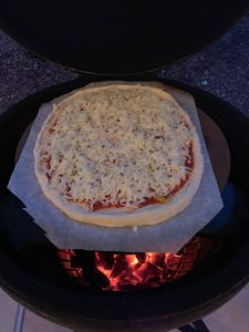 Pepperoni Pizza on Pizza Stone inside Big Green Egg