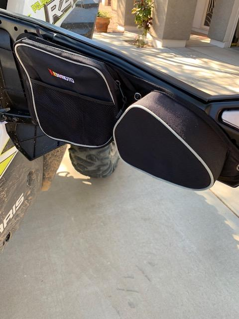 Kemimoto RZR storage bag attached to door.
